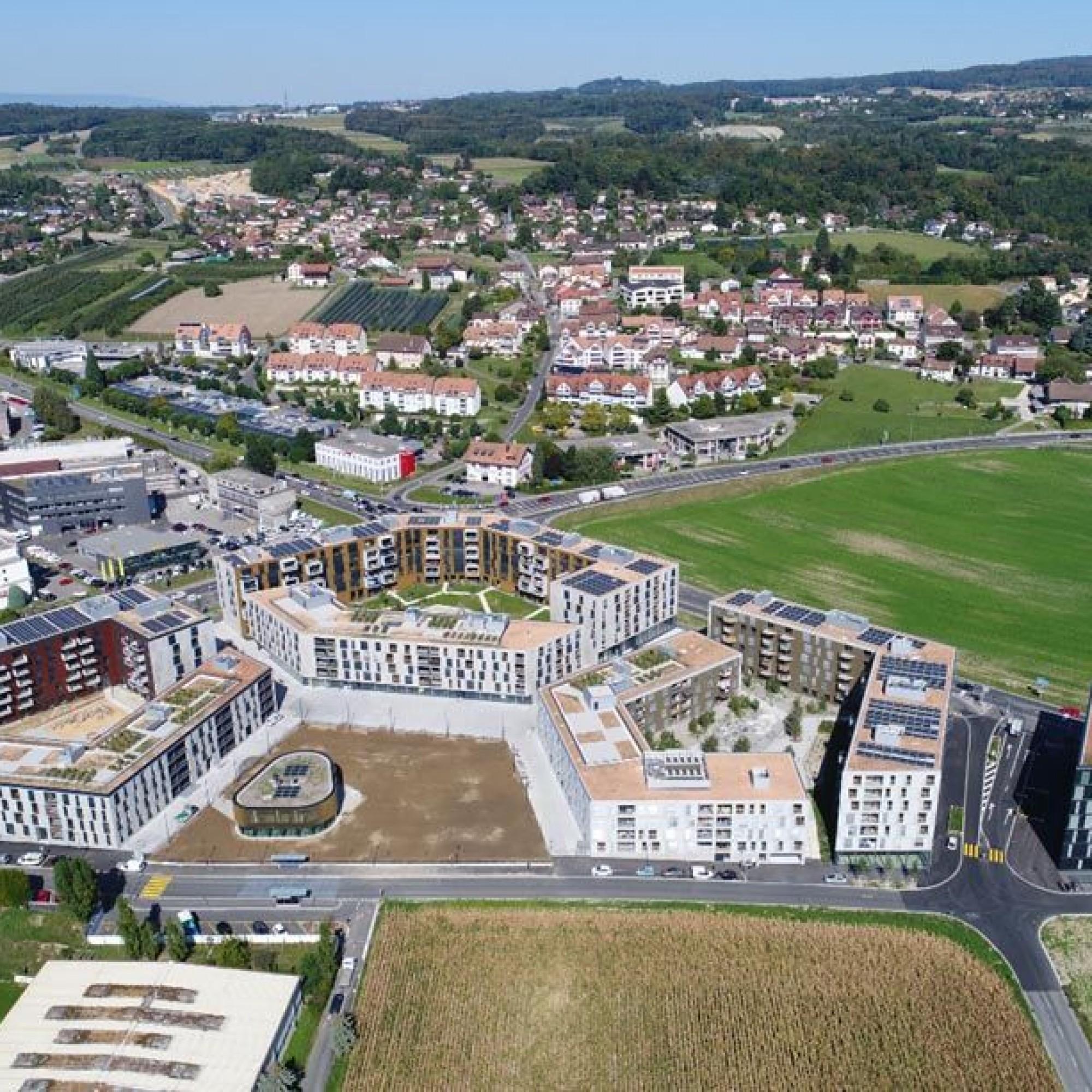 Oassis, Crissier. six immeubles résidentiels de 550 appartements et un immeuble de bureaux.