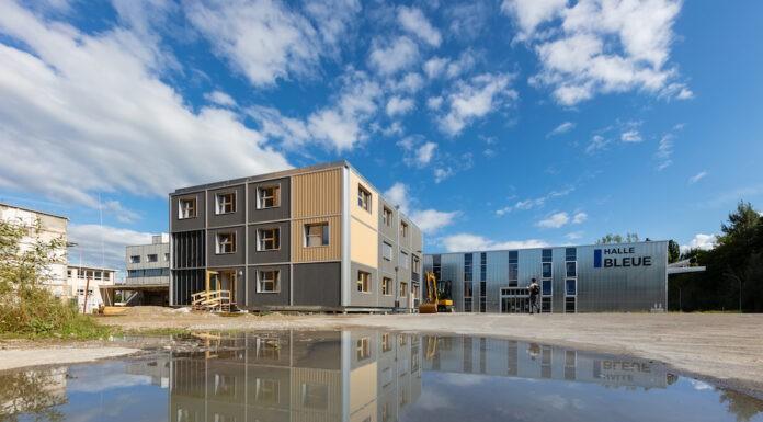 wood-iD le concepteur innovateur créé par Bluefactory à Fribourg permettant d'accueillir des petites et moyennes entreprises en son sein