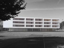Le projet comprenait 60 salles de classe, une salle de gymnastique triple, une bibliothèque et un aula de 280 places